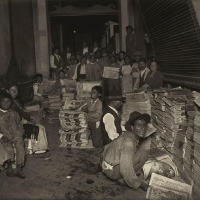 Although a good part of the population did not know how to read, more than ten newspapers were circulated in the city. They were sold on the street by hawkers called voceadores. Newsboys who peddled the daily paper El Demócrata appear in this photograph. Mexico City, ca. 1925.