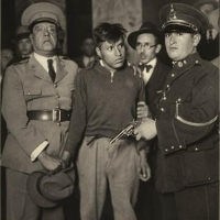 "This ""crime story"" photograph established the image of the delinquent with his weapon, under the watchful gaze of his arresting officers and jailers. Mexico City, ca 1935."
