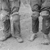 Cotton pickers with knee pads, Lehi, Arkansas. Russell Lee, 1938.