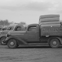 Trucks loaded with mattresses, San Angelo, Texas. These mattress factories use much local cotton. Russell Lee, 1939.