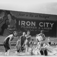 Homemade swimming pool for steelworkers' children, Pittsburgh, Pennsylvania. July, 1938.