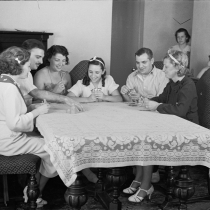 Family group playing cards in one of the new homes on the Hightstown Project, New Jersey. 1936