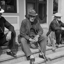 Fair at Albany, Vermont. The old timers take to the steps of the general store. 1936