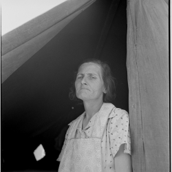Migrant woman from Arkansas living in contractor's camp near Westley, California. She would prefer to live in a government camp, but the contractor system prevents, because of control over allocations of work. 1939