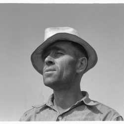 """Washington, Yakima Valley, near Wapato. Rural rehabilitation client (Farm Security Administration). Portrait of Chris Adolf. """"My father made me work. That was his mistake, he made me work too hard. I learned about farming but nothing out of the books."""" August, 1939."""
