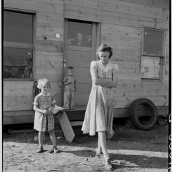 """Young mother, twenty five, says """"Next year we'll be painted and have a lawn and flowers."""" Rural shacktown, near Klamath Falls, Oregon. October, 1939."""
