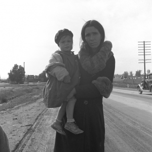 """On U.S. 99. Near Brawley, Imperial County. Homeless mother and youngest child of seven walking the highway from Phoenix, Arizona where they picked cotton. Bound for San Diego, where the father hopes to get on relief """"because he once lived there."""". 1939"""