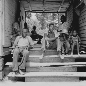 Zollie Lyon, Negro sharecropper, home from the field for dinner at noontime, with his wife and part of his family. Wake County, North Carolina. July, 1939.