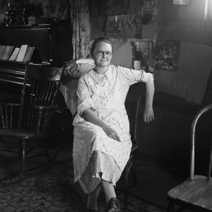 Mrs. Hull, in one room basement dugout home, late afternoon. Dead Ox Flat, Malheur County, Oregon. October, 1939.