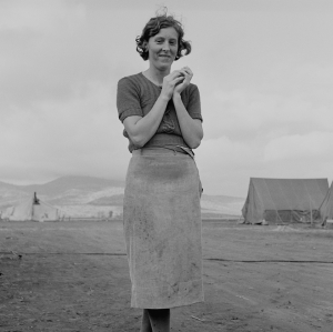 Young migrant mother has just finished washing. Merrill FSA (Farm Security Administration) camp, Klamath County, Oregon. October, 1939.