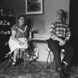 Untitled (couple at home woman pointing), 1950-60's