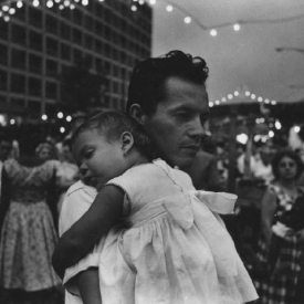 Untitled (man with sleeping child), 1950-60's