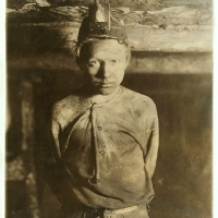 Trapper Boy, Turkey Knob Mine, Macdonald, W. Va. Boy had to stoop on account of low roof, photo taken more than a mile inside the mine. Witness E. N. Clopper. MacDonald, West Virginia. 1908