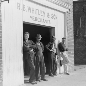Men standing around outside general store, Wendell, Wake County, North Carolina.