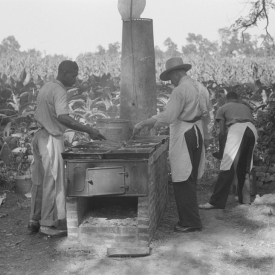 Cooking fried supper for a benefit picnic supper on the grounds of St. Thomas' Church. Near Bardstown, Kentucky. 1940