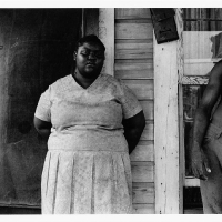 Man without shirt and woman on porch, Battle's Quarters, 1971.