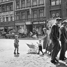 Street scene with a swastika flag on a storefront (at left), Berlin, ca. 1935-36. © Mara Vishniac Kohn, courtesy International Center of Photography