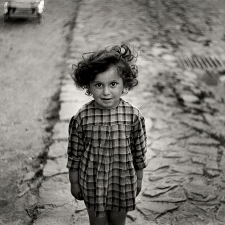 Girl in plaid dress, Mukacevo, ca. 1935-38. © Mara Vishniac Kohn, courtesy International Center of Photography