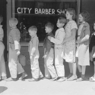 Schoolchildren waiting in line to go to the movies, San Augustine, Texas. 1939