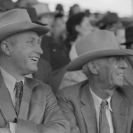 Spectator laughing at the antics of a cowboy clown at the rodeo of the San Angelo Fat Stock Show, San Angelo, Texas. 1940