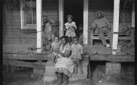 One of tenant families on their porch, Marcella Plantation, Mileston, Mississippi Delta, Mississippi